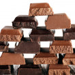 Pyramid of squared chocolate on wooden table — Stock Photo #77194277