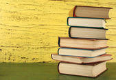 Stack of books on wooden background — Stock Photo