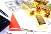 Gold bullion with money on table close up — Stock Photo