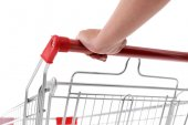 Young woman with shopping cart close up — Stock Photo