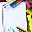 Notebook and bright school stationery on old wooden table — Stock Photo #77240824