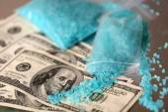 Drug laboratory: blue methamphetamine and money on table close up — Stock Photo