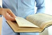 Young man reading book close up — Stock Photo