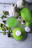 Spa still life in green color on wooden table, closeup — Stock Photo