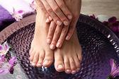 Female feet at spa — Stock Photo