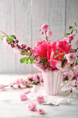 Spring bouquet in colorful mug — Stock Photo