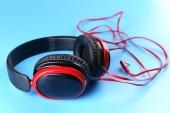 Headphones on blue background — Stock Photo