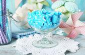Sweet candies in glassware — Stock Photo