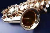 Golden saxophone on blue background — Stock Photo