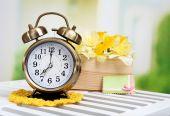 Alarm clock on table, on light background — Stock Photo