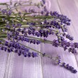 Lavender flowers on table close up — Stock Photo #77562324