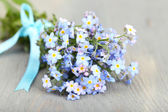 Forget-me-nots flowers on wooden background — Stock Photo