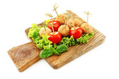 Meat balls on wooden cutting board isolated on white — Stock Photo
