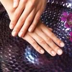 Female hands at spa manicure procedure — Stock Photo #77574394