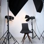 Photo studio with modern interior and lighting equipment — Stock Photo #77574532