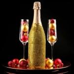 Decorative champagne bottles on dark background — Stock Photo #77574602