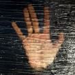 Female hand behind frosted glass, close-up — Stock Photo #77574950