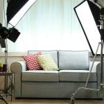 Photo studio with modern interior and lighting equipment — Stock Photo #77574964