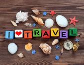 Reisen-Inschrift auf hölzernen Hintergrund — Stockfoto