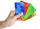 Hand holding credit cards, isolated on white — Stock Photo