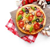 Tasty pizza with vegetables and basil on cutting board isolated on white — Stock Photo