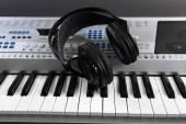 Headphones on synthesizer close up — Stock Photo