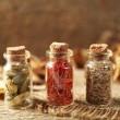 Assortment of spices in glass bottles — Stockfoto #77979512