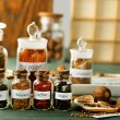 Assortment of spices in glass bottles — Stockfoto #77979670