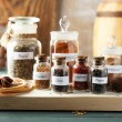 Assortment of spices in glass bottles — Stockfoto #77979678