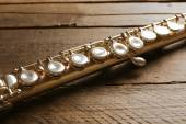 Flute on wooden background — Stock Photo