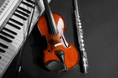 Musical instruments on dark background — Stock Photo