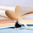 Pages of book curved into heart shape — Stock Photo #77995894