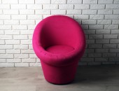 Modern chair on brick wall background — Stock Photo