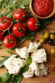 Ingredients of Mediterranean cuisine, on wooden board, top view — Stock Photo