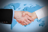 Business handshake on world map background — Stock Photo