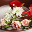 Tableware with flowers on table close up — Стоковое фото #78070722