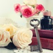 Fresh roses with old book and letters on color wooden table, on light background. Vintage concept — Stock Photo #78073278