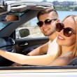Young couple in cabriolet, outdoors — Stock Photo #78076906