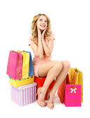 Beautiful young woman with shopping bags and boxes isolated on white — Stock Photo