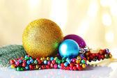 Beautiful Christmas balls on light blurred background — Stock Photo