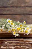 Old books with dry flowers on wooden background — Stock Photo