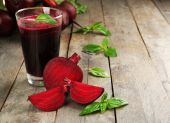 Glass of beet juice on wooden background — Stock Photo