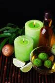 Spa still life in green color on bamboo mat on dark background — Stock Photo