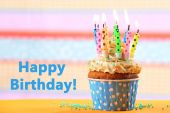Birthday cupcake with candles — Stock Photo