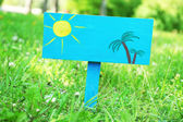 Wooden signboard over grass, outdoors — Stock Photo