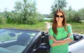 Pretty girl standing near cabriolet, outdoors — Stock Photo
