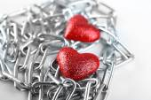 Two red hearts with metal chain, closeup — Stock Photo