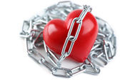 Heart shape with metal chain — Stock Photo