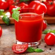 Glass of tomato juice on wooden table, closeup — Stock Photo #78883106
