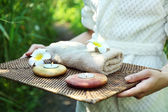 Female hands with tray of spa products — Stock Photo